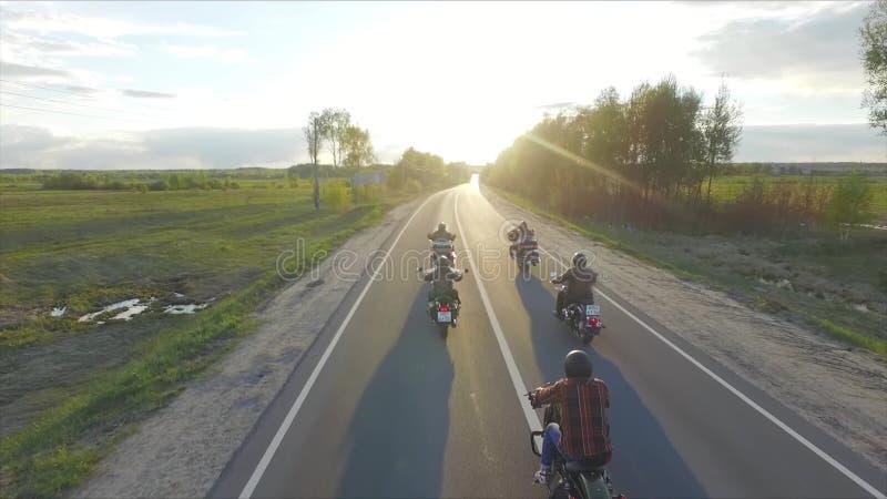 Bikers ride into the sunset. Aero stock video