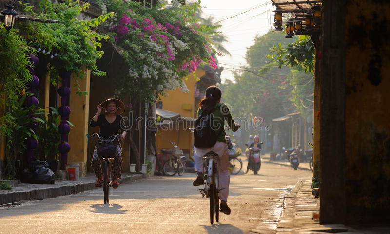 Vietnamese bikers in Hoi An stock photography