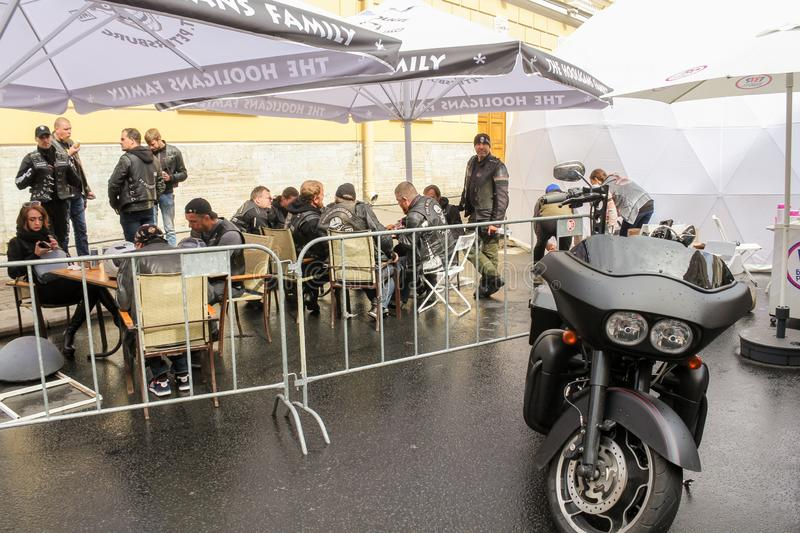 Bikers at the tables under the umbrellas stock images