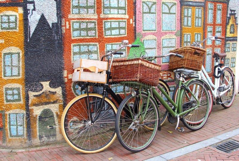 Bikes and urban street art canal houses, Leeuwarden, Friesland, Netherlands stock image