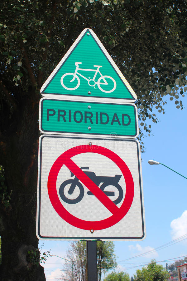 Only bikes allowed street sign no motorcicles. Only bikes allowed sign with text prioridad, priority in spanish, used in a selected line of the street just for stock images