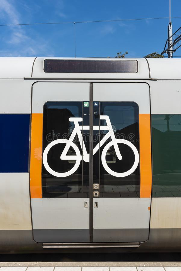 Bikes allowed symbol on train doors. Bikes allowed on train. Bicycle pictogram on train doors standing at platform stock photography