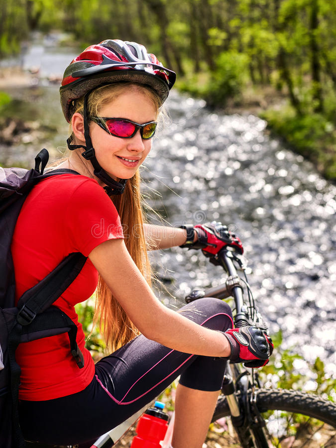 Bikes bicyclist girl rides bicycle mountains. Woman on vehicle mountaineering . royalty free stock photos