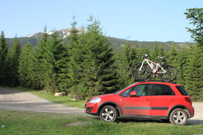 Bikes on a car in the mountain stock image