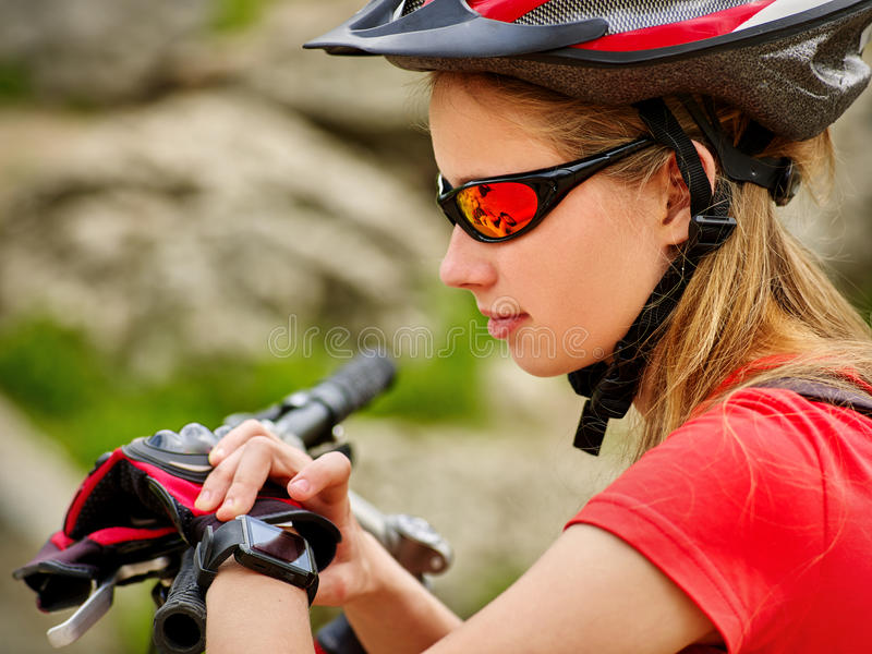 Bikes cycling girl. Bicyclist girl watch on smart watch. royalty free stock image