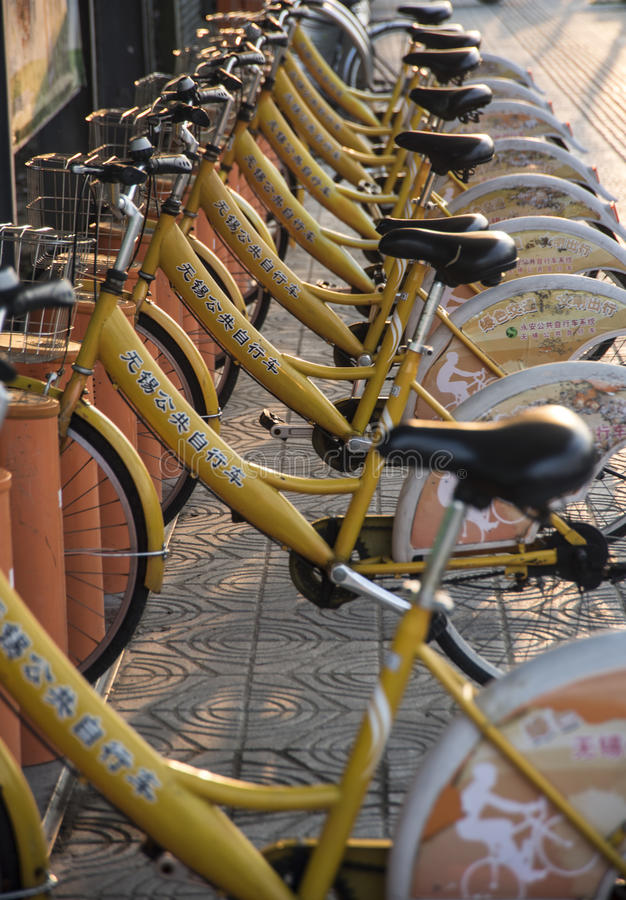 Bikes for hire, China. A row of bicycles ready for hire stock photography