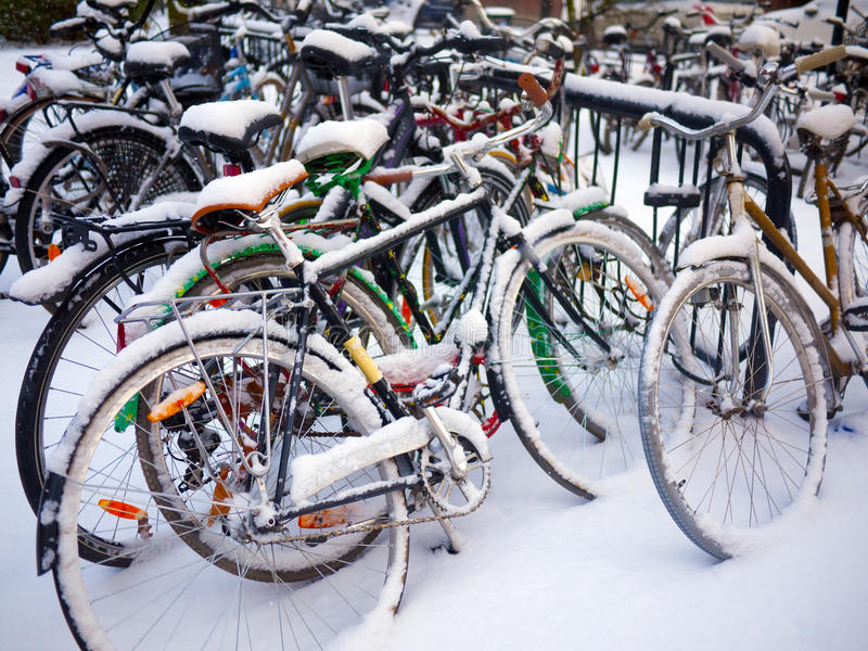 Bikes parked in winter royalty free stock photos
