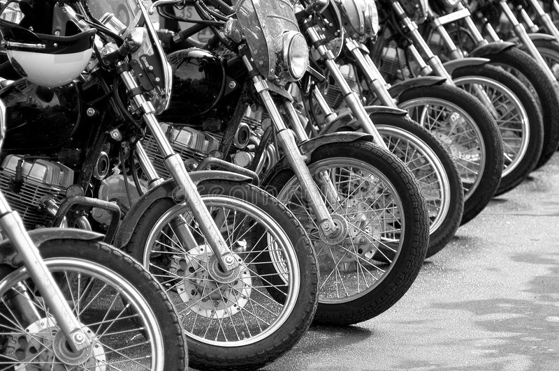 Bikes in a row - cop motorcycle lineup at protest. Motorcycle lineup: A row of police motorcycle at a protest rally royalty free stock photos