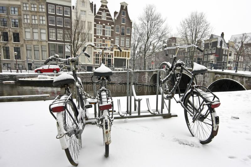 Download Bikes In The Snow In Amsterdam Netherlands Stock Image - Image: 12398653