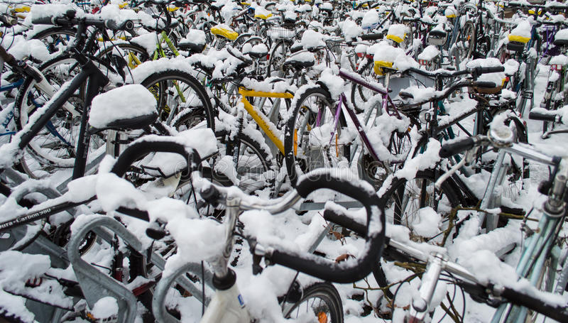 Bikes snow covered royalty free stock images