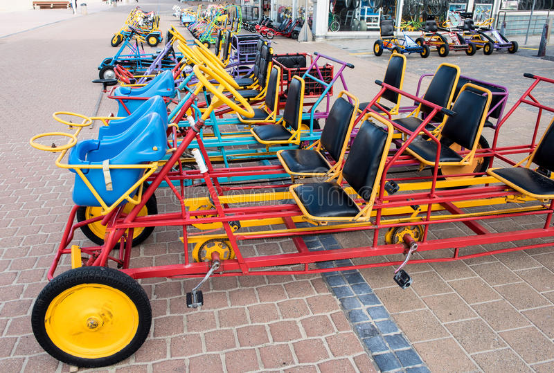 Bikes and warcars to borrow on the promenade of Koksijde, Belgium.  stock images
