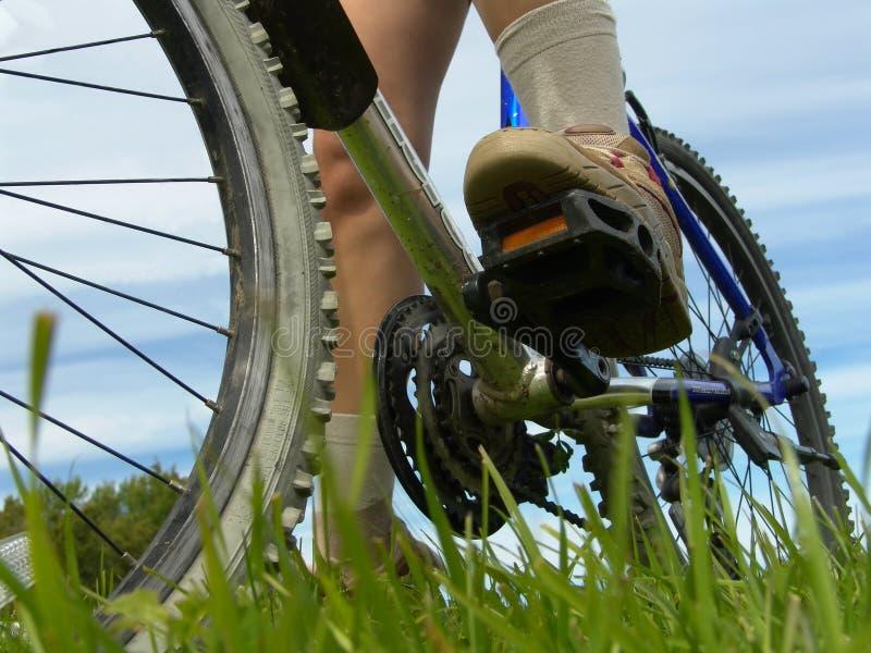 Biking. Feet and bike