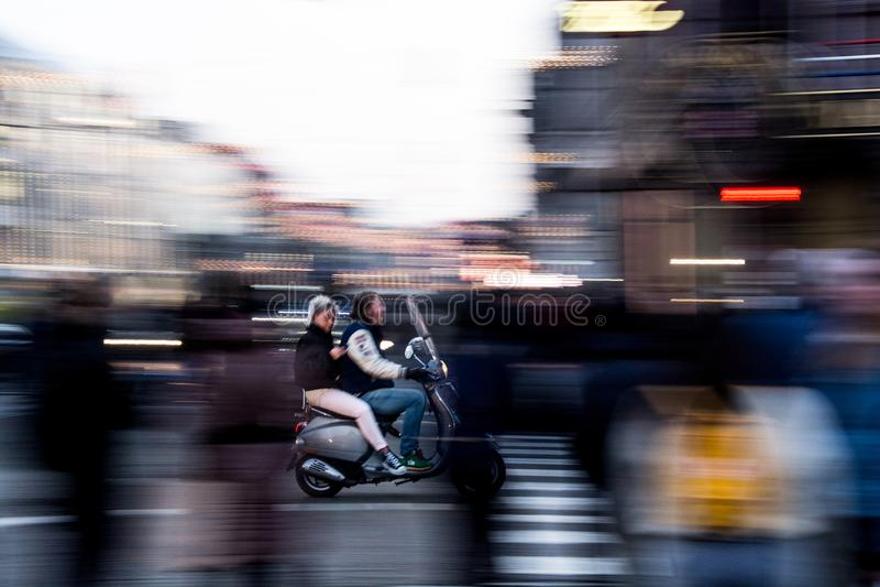 Biking in Amsterdam royalty free stock image