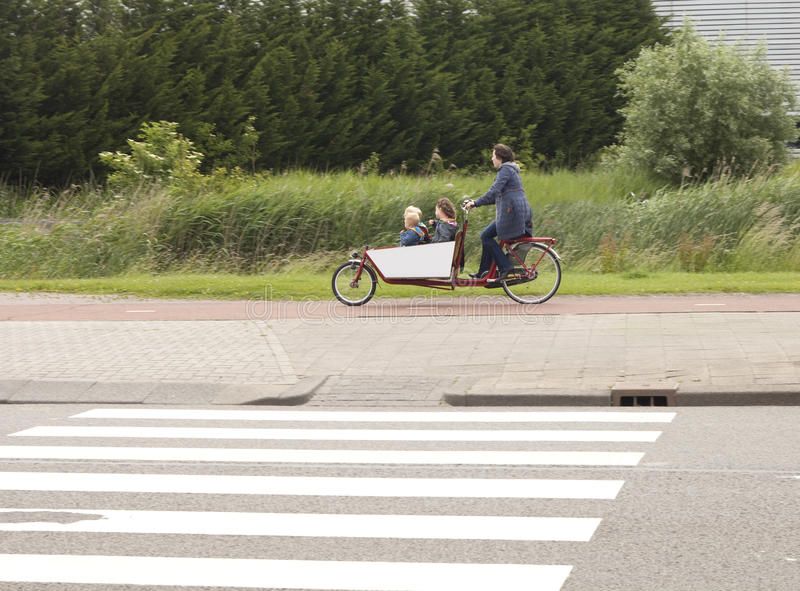Download Biking The Children To School In The Netherlands Editorial Stock Image - Image: 25270339