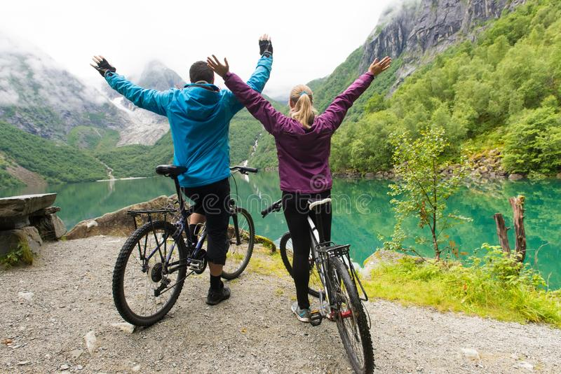 Biking in Norway against picturesque landscape royalty free stock images