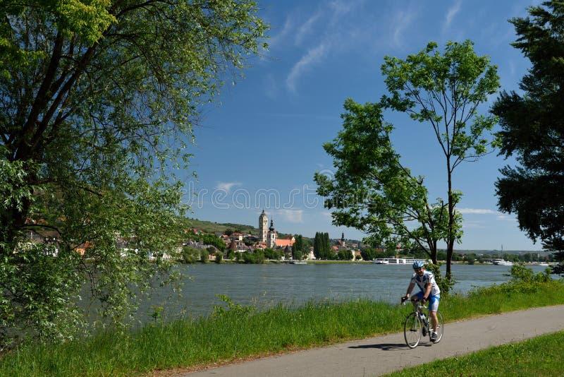 Biking at Krems an der Donau, Wachau, Austria. Biking trail along Danube river near by Krems an der Donau city in Wachau - Austria stock photos