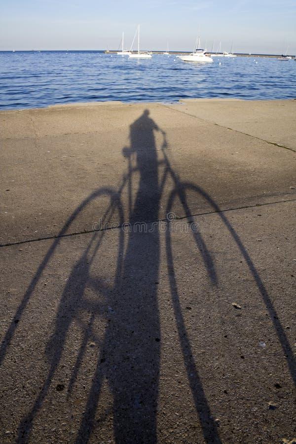 Biking by the lake stock photo