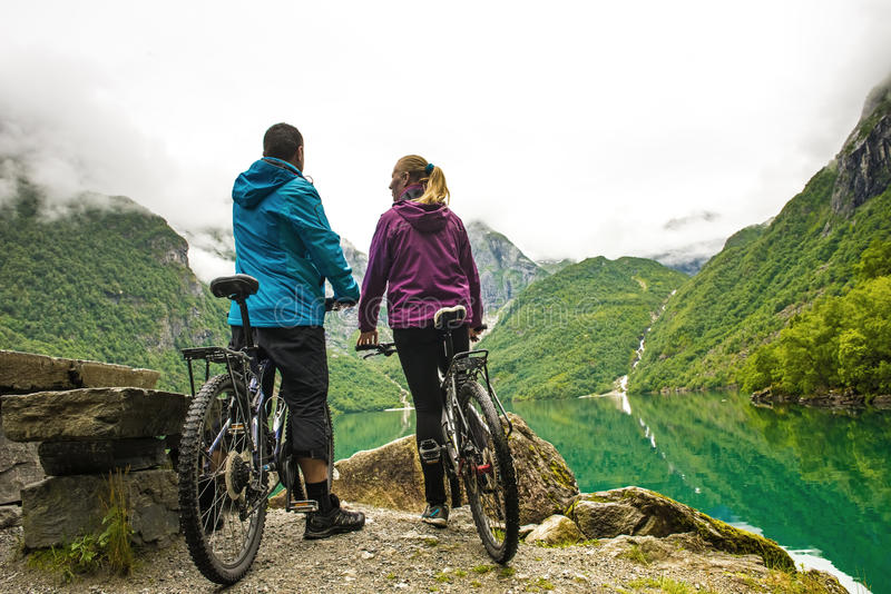 Biking in Norway against picturesque landscape stock image