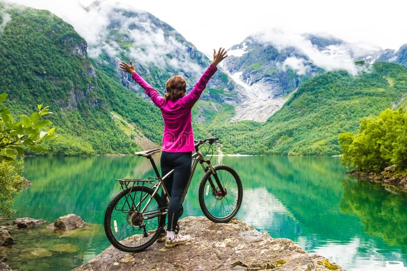 Biking in Norway against picturesque landscape royalty free stock photo