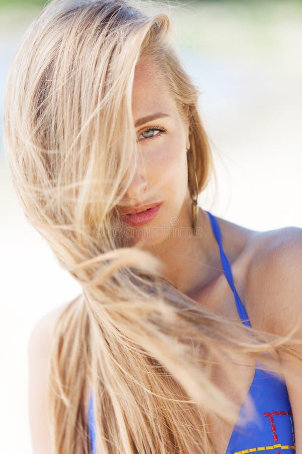 Bikini desire. Seductive girl with sandy face stock image
