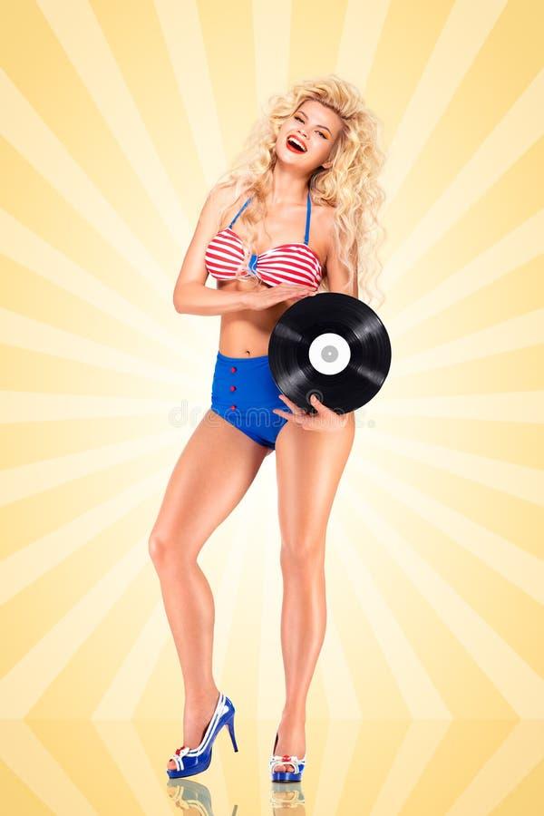 Bikini en vinyl stock afbeeldingen