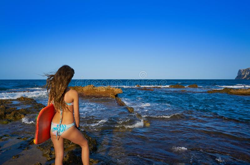 Bikini girl hording surf board in beach stock image