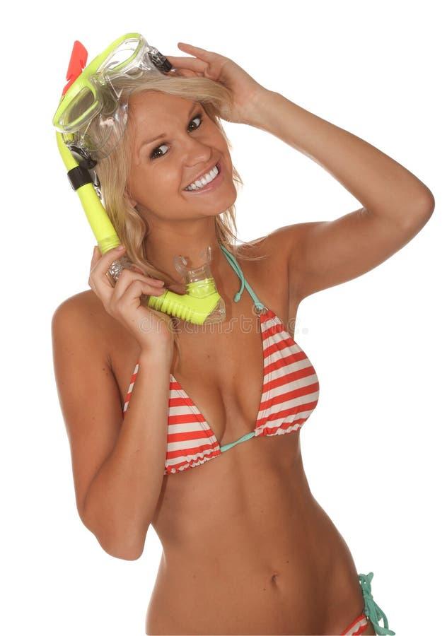 Bikini Girl with Scuba Mask. Pretty bikini girl with a scuba mask and snorkel in striped bikini royalty free stock image