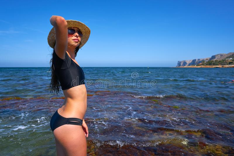 Bikini girl in summer Mediterranean beach having fun royalty free stock photos