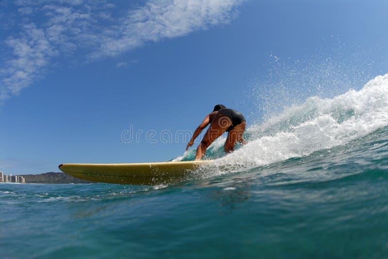 A bikini longboard surfer stock image