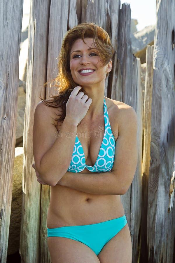 Bikini Model Against Wood Fence royalty free stock photos