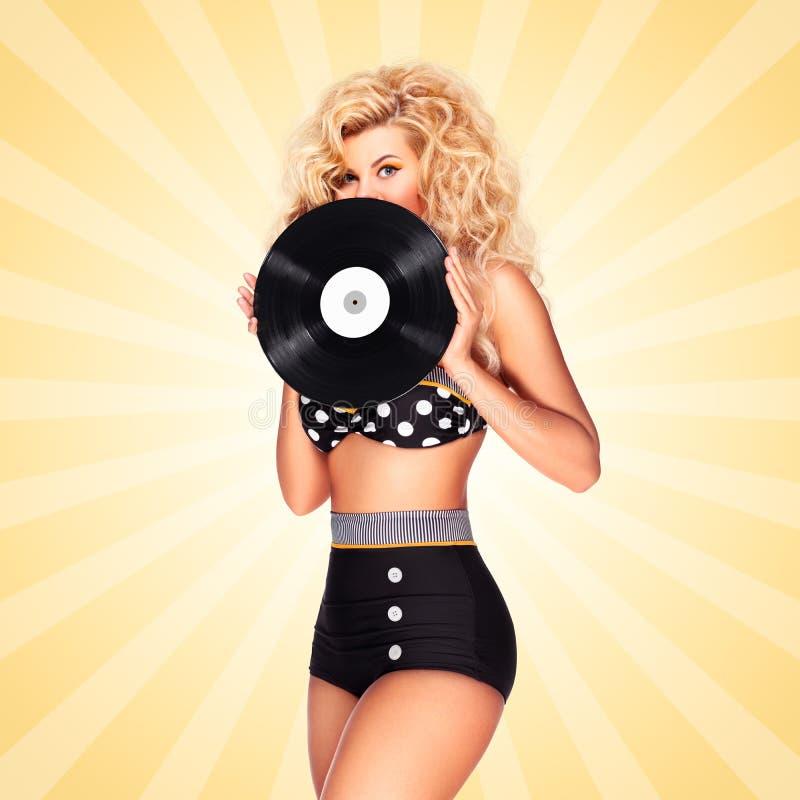 Bikini och vinyl arkivfoton