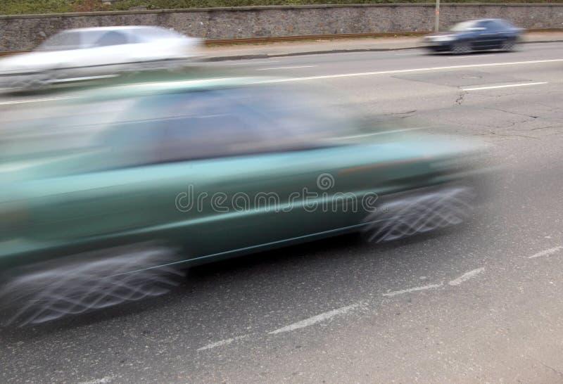 Bil med rörelseblur arkivbild