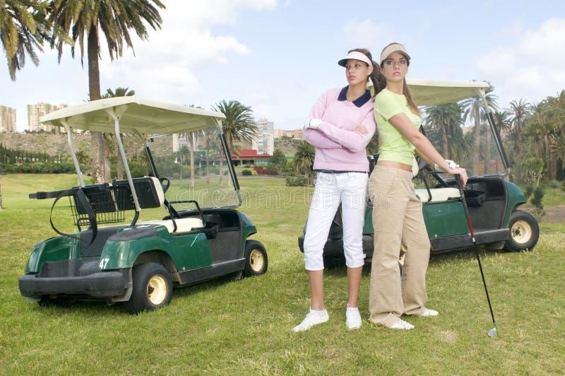 bilar golf henne spelare nätt två royaltyfri foto