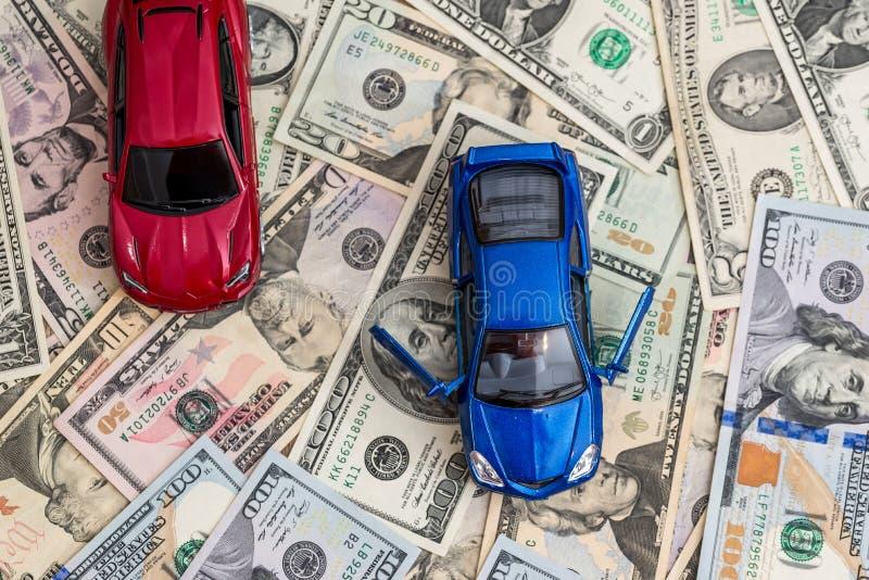 bilar med dollaren arkivbild