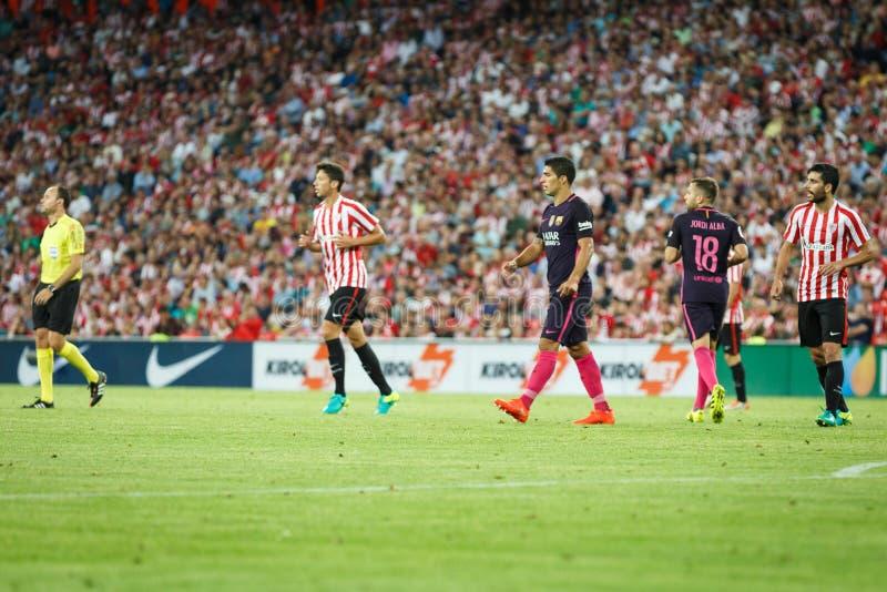 BILBAO, ESPAÑA - 28 DE AGOSTO: Luis Suarez y Jordi Alba, jugadores del FC Barcelona, durante el partido de liga español entre Bil fotos de archivo libres de regalías