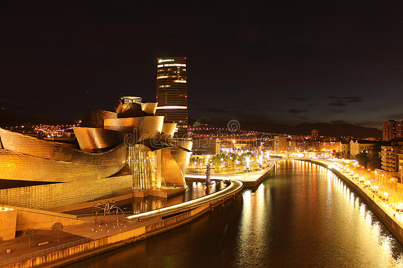 Bilbao at night. Bilbao, the capital of Euskadi, represented by the Guggenhein Museum stock photos