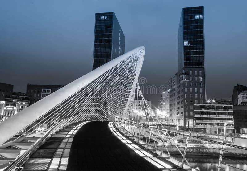 Nightview of Zubizuri bridge and Isozaki towers in Bilbao, Spain stock image