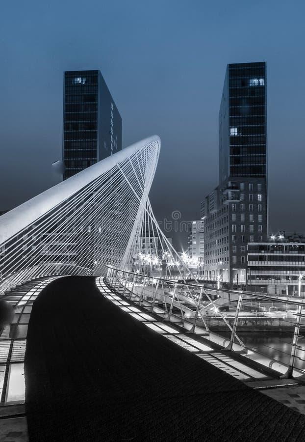 Nightview of Zubizuri bridge and Isozaki towers in Bilbao, Spain stock photography
