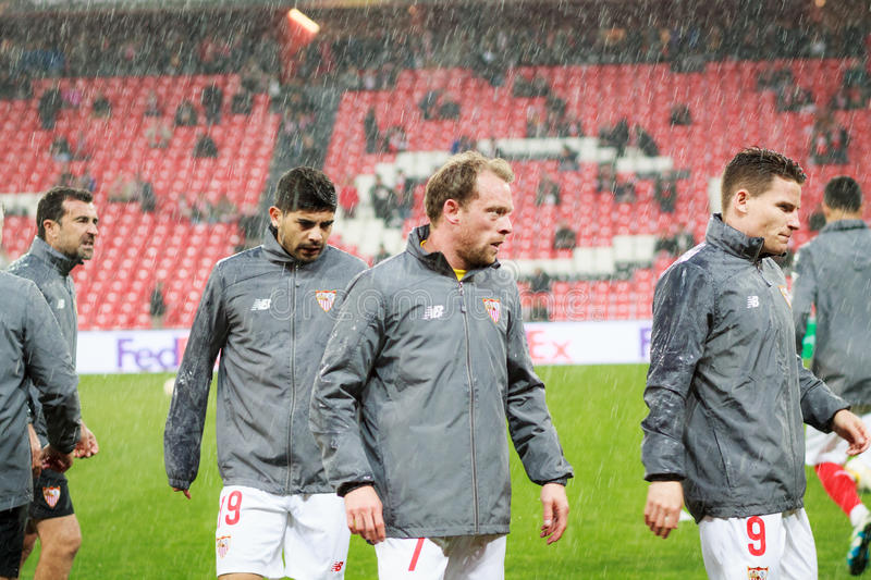 BILBAO, SPAIN - ARPIL 7: Ever Banega, Michael Krohn-Gehli and Kevin Gameiro before the match between Athletic Bilbao and Sevilla stock image