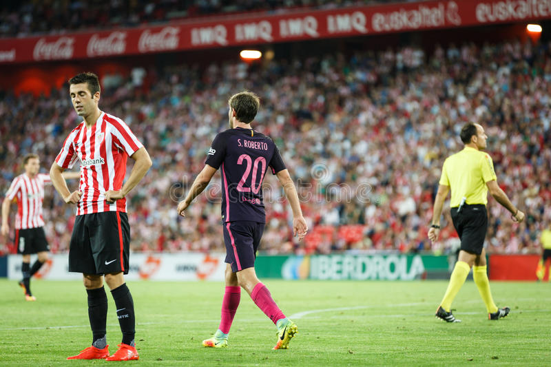 BILBAO, SPAIN - AUGUST 28: Sergi Roberto, FC Barcelona player, and Markel Susaeta, Bilbao player, in the the match between Athleti royalty free stock photography