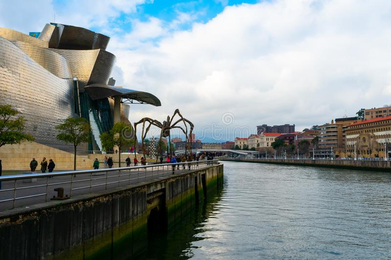 Bilbao, Spain/Europe; 29/12/18: Guggenheim museum and spider sculpture called Maman in Bilbao, Spain. Euskadi, nervion, exterior, building, biscay, cityscape royalty free stock image