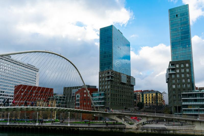 Bilbao, Spain/Europe; 29/12/18: Zubiuri bridge and Isozaki Atea towers in Bilbao, Spain. Landmark, nervion, business, twin, basque, building, cityscape royalty free stock photos
