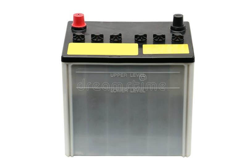 Bilbatteri p? en vit bakgrund royaltyfria foton