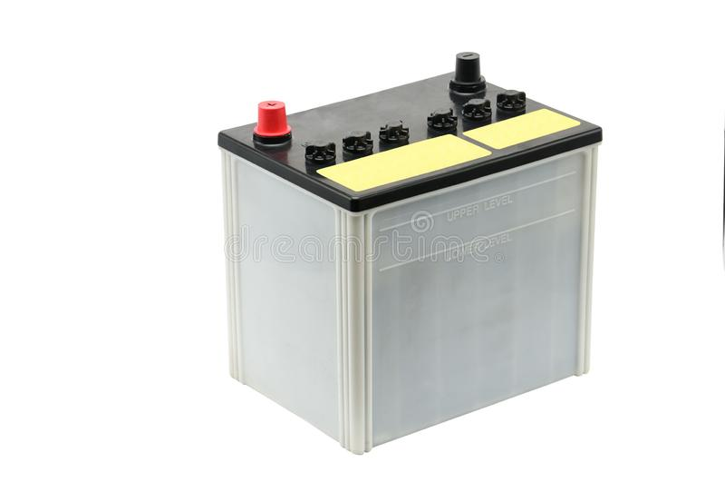 Bilbatteri p? en vit bakgrund royaltyfri foto