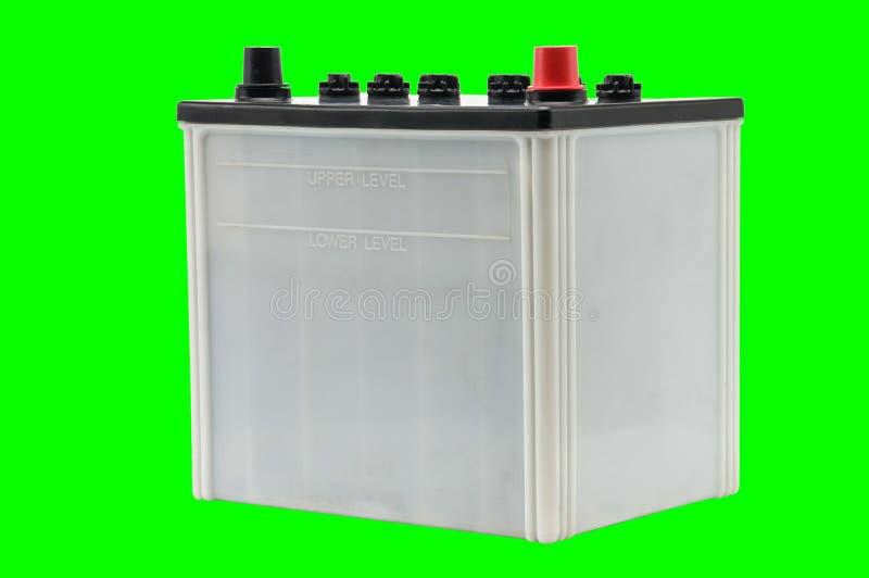 Bilbatteri p? en vit bakgrund royaltyfria bilder