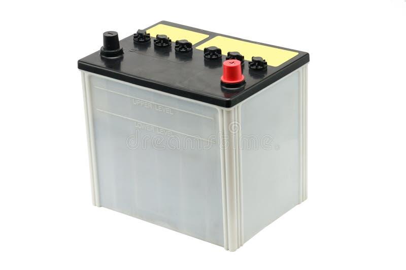 Bilbatteri p? en vit bakgrund arkivbild