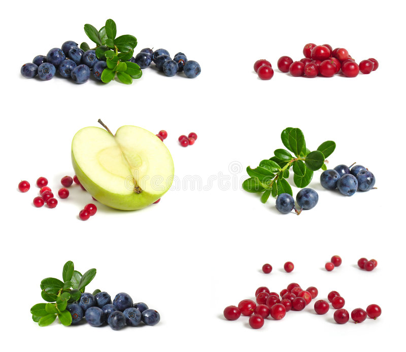 Bilberries, apple and cranberries. Scattering of bilberries, apple and cranberries on white background royalty free stock images