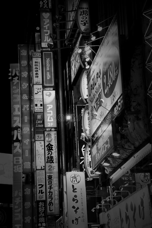 Bilboards lights in Tokyo. TOKYO - JUNE 19, 2016: Billboards, ads and lights in Shinjuku`s Kabuki-cho district in Tokyo, Japan. The area is a nightlife district stock photos
