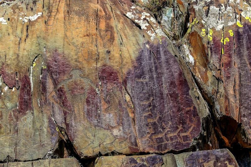 Bild av den forntida jakten på väggen av grottaockran Historisk konst axeln royaltyfria foton