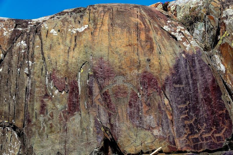 Bild av den forntida jakten på väggen av grottaockran Historisk konst axeln royaltyfria bilder